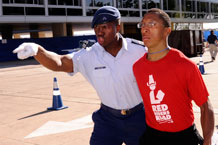 Cadet 2nd Class James Colvin motivates Basic Cadet Michael Craig to move along quickly as inprocessing begins for the Class of 2014 at the Air Force Academy, Thursday. Photo by Mike Kaplan