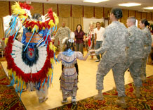 Audience members join the Sweetwater Dancers in a friendship dance at the National Native American Heritage Month observance at the Elkhorn Conference Center Nov. 22.