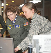 Second Lt. Sarah Stewart, 22nd Space Operations Squadron Mission Integration program manager, shows Lt. Gen. Susan Helms, 14th Air Force commander, some of the tasks involved with daily operations. (U.S. Air Force photo/ Dave Ahlschwede)