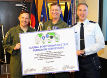 (Pictured from left to right) Col. Harold Martin, Air Force Space Command Positioning Navigation and Timing command lead; Col. Wayne Monteith, 50th Space Wing commander; and Col. Bernard Gruber, the director of the Global Positioning Systems Directorate; pose for a photo during the turn over ceremony for two Global Positioning System ground system upgrades here April 14. The ceremony signified a group effort between the wing, AFSPC and the Space and Missile Systems Center and their continued commitment to providing the gold standard in PNT service. (U.S. Air Force photo/Dennis Rogers)