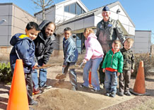 Andy Schlosberg, Colorado Assistant District Forester, and Col. Wayne Monteith, 50th Space Wing commander, plant a tree in observance of Arbor Day with children from the Child Development Center, here. This celebration marks Schriever Air Force Base's 13th consecutive annual Tree City USA Award and the base's efforts to remain a green installation. (U.S. Air Force Photo/Dave Ahlschwede)