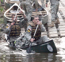 Staff Sgt. Bryan Achee and 1st Lt. Thomas Goodman, both with 2nd Battalion, 12th Infantry Regiment, 4th Brigade Combat Team, 4th Infantry Division, leave the shore in a canoe on the first day of the Best Ranger Competition at Fort Benning, Ga., April 15.