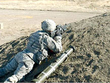 "A Soldier from 1st Squadron, 10th Cavalry Regiment, 2nd Brigade Combat Team, 4th Infantry Division, engages the enemy during the squadron's ""Bison Strike"" dismounted field training at Fort Carson April 2."