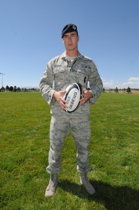U.S. Air Force photo/Staff Sgt. Patrice Clarke Senior Airman Nicholas Rosales, 50th Security Forces Squadron, poses with a rugby ball at Schriever Air Force Base, Colo., Sept. 6. Rosales was a member of the All Air Force Rugby team in 2012 and recently tried out for a one-time, All Air Force game against the Australian Air Force team.