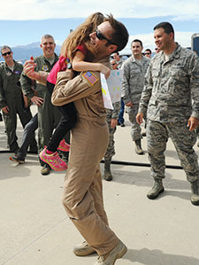 (U.S. Air Force photo/Rob Bussard) Maj. Jon Magee, a C-130 pilot with the 731st Airlift Squadron greets his daughter Alyssa after landing Sept. 18, 2013 at Peterson Air Force Base, Colo. Magee had just returned from a deployment to Southwest Asia along with approximately 150 other members of the Air Force Reserve Command's 302nd Airlift Wing.