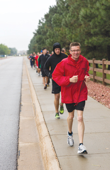 (Courtesy photo)  Chief Warrant Officer Marc Lafontaine, Canadian Forces Support Unit (Colorado Springs), leads a group of runners during the 2nd annual Terry Fox Run Sept. 13. This year's Terry Fox Run, held at Peterson AFB, raised $400 toward cancer research.