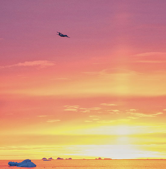 (U.S. Air Force photo/Tech. Sgt. Jeffrey Mikell) THULE AIR BASE, Greenland  —  A Royal Canadian Air Force C-130J takes off at dusk over North Star Bay during Operation BOXTOP II 2013. Three C-130s flew 24-hour operations to deliver vital supplies and fuel to remote arctic outposts in northern Canada.