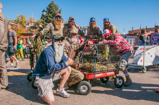 (U.S. Air Force photo/Staff Sgt. Julius Delos Reyes) Members of the 50th Civil Engineer Squadron Duck Commando Engineers pose for a photo during the 18th annual Coffin Race and Parade Oct. 26 in Manitou Springs, Colo. The team clocked in at 25.89 seconds to grab 10th place.