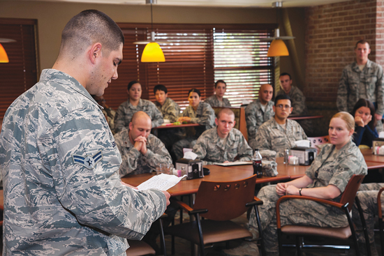 (U.S. Air Force photo/Craig Denton) PETERSON AIR FORCE BASE, Colo. — Airman 1st Class Alexander Smalldon, 21st Security Forces Squadron, reads his speech explaining what the uniform means to him as a first term Airman during the First Term Airman Course Hand-off Luncheon Sept. 19 at the Aragon dining facility. Smalldon was one of two Airmen who volunteered to speak during the luncheon.