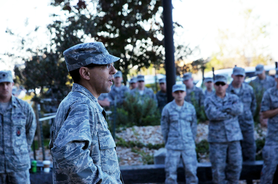 (U.S. Air Force photo/Staff Sgt. Patrice Clarke) Col. Bill Liquori, 50th Space Wing commander, addresses members of the 50th Space Wing regarding the government shutdown after a wing-wide reveille ceremony early Oct. 3, 2013 here. Wing leadership continues to use multiple methods to ensure members of Team Schriever have the most up-to-date information regarding the government shutdown.