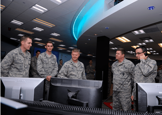 (U.S. Air Force photo/Christopher DeWitt)  Col. Bill Liquori, 50th Space Wing commander, (far right) accepts satellite control authority of the Wideband Global SATCOM-6 satellite from the 14th Air Force and delegates SCA to Lt. Col. Chadwick Igl, 3rd Space Operations Squadron commander, (center) here Dec. 17.