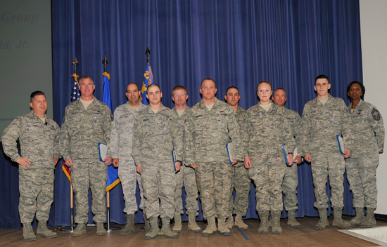 (U.S. Air Force Photo/Robb Lingley)  PETERSON AIR FORCE BASE, Colo. - Nine Airmen from the 21st Civil Engineer Squadron received the Air Force achievement medal for their efforts removing several thousand cubic yards of earth and tons of rock from the north portal entrance of Cheyenne Mountain Air Force Station, during a ceremony at the base auditorium Dec. 18. The 21st CES Airmen worked as a joint team with Soldiers from Fort Carson to clear a usable roadway into the mountain within 48 hours of beginning the cleanup.