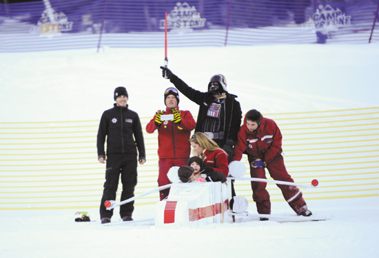 (U.S. Air Force photo/Staff Sgt. Jacob Morgan) KEYSTONE, Colo. — Lt. Col. Jason Terry, 52nd Airlift Squadron commander, dressed as Darth Vader, and his family prepare to slide down Discovery Slope of Keystone Mountain during the SnoFest Cardboard Derby Jan. 25. The Terry family competed in the family division against nine other craft and won the most creative trophy.