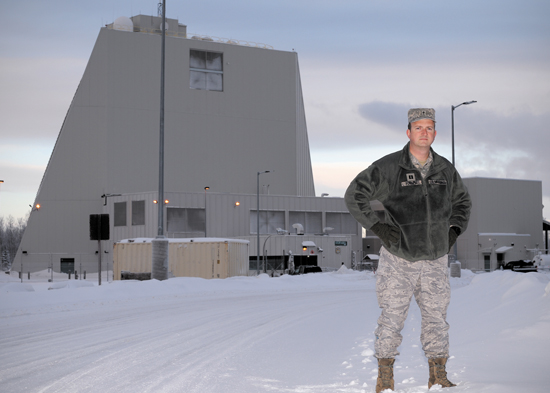(U.S. Air Force photo by Senior Airman Shawn Nickel/Released) Chaplain (Capt.) Thomas Fussell, 354th Fighter Wing protestant chaplain, stands in front of the phased array radar at Clear Air Station, Alaska, Feb. 6, 2014. Chaplains from Eielson Air Force Base and Joint Base Elmendorf Richardson, Alaska, travel the icy roads to the remote radar station every other week to aid the aid the Airmen there in completing the mission of providing early warning of intercontinental ballistic missiles and submarine-launched ballistic missiles.