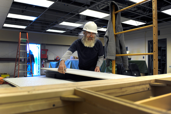 U.S. Air Force Photo/Dennis Rogers Government contractor, Mitch Coszalter, fits ceiling tiles Friday during the renovation of Building 805. Contractors are creating an office and workspace inside the warehouse for the Schriever Outdoor Recreation, Information, Tickets and Travel office.