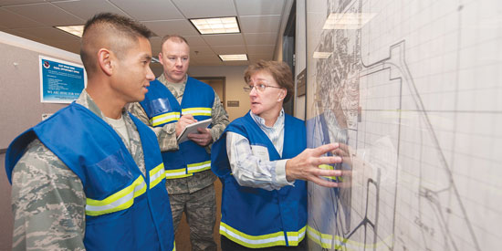 (File photo) A group of inspectors discuss a past wing readiness exercise. The 21st Space Wing was recently recognized by the Air Force Inspector General as the first active duty or Reserve wing in the Air Force to fully implement the Air Force Inspection System and become commander's inspection program capable.