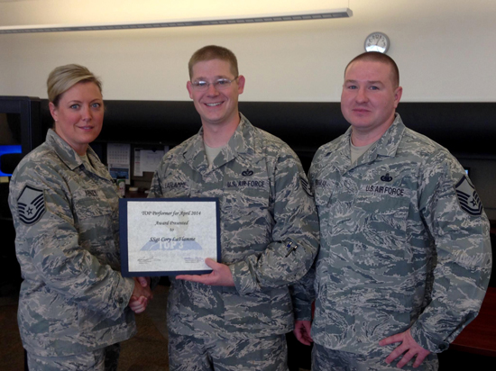 (Courtesy photo) Staff Sgt. Corey LaFlamme, 50th Space Wing Inspector General office, recently received the Top 3 Performer of the Month for April at Schriever Air Force Base, Colo. LaFlamme built scenarios and led the wing inspection team members during the April 2014 wing inspection, and was also the lead inspector for the 50th Comptroller Squadron. He manages and leads the Management Internal Control Toolset and self-assessment programs as well as more than 65,000 checklist requirements, ensuring the installation is in compliance with readiness and inspection standards.
