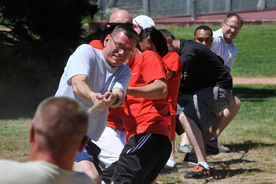(U.S. Air Force photo/Dennis Howk)  PETERSON AIR FORCE BASE, Colo. – Col. Reginald Ash III, 21st Mission Support Group commander, and the 21st MSG tug-of-war team struggle against their opponents June 19 here. Tug-of-war was one of more than 30 events held at Team Pete's 2014 sports and field day.