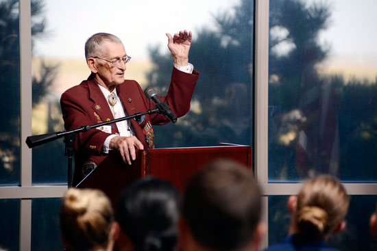 U.S. Air Force photo/Christopher DeWitt Retired U.S. Army Master Sgt. Ed Beck speaks to Schriever members during the closing ceremony of POW/MIA remembrance week Sept. 18, 2014, at Schriever Air Force Base, Colo. Beck was a POW during World War II and managed to escape after six months in captivity.