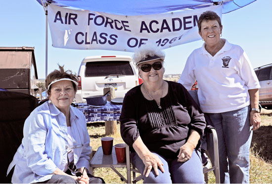 (U.S. Air Force photo/Airman 1st Class Rose Gudex)  U.S. AIR FORCE ACADEMY, Colo. -- Regular tailgaters and wives of three 1961 Academy graduates, (left to right) Jo Jones, Nancy Wilhelm and Lynda Neel pose for a photo in the tent they spend every Falcon home game under. The ladies have been tailgating at Falcon football games since 1984. Tailgating takes place before every Falcon home game to bring fans together to get pumped for the game.