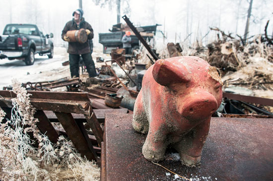 U.S. Air Force photo/Staff Sgt. Julius Delos Reyes A piggybank standing atop other debris is among the remnants of a home destroyed by the 2013 fire at Black Forest, Colo. Members of the 25th and 379th Space Range Squadrons piled scrap metal and other materials Nov. 26, 2014, at Black Forest, Colo., as part of the squadrons' volunteer effort through the non-profit Black Forest Together.