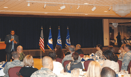 (U.S. Air Force photo by Dave Smith) PETERSON AIR FORCE BASE, Colo. — Chip Simmons, founder and president of After the Game Ministries and chaplain for the Denver Broncos, talks about how prayer brings peace during times of transition. Simmons was the featured speaker for the National Prayer Luncheon March 11 at The Club.