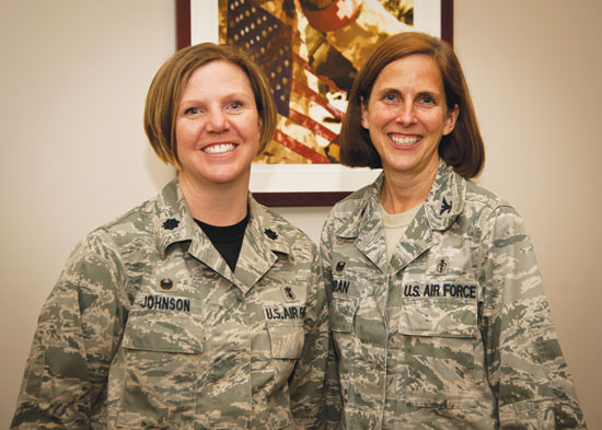 (U.S. Air Force photo/Staff Sgt. J. Aaron Breeden)  PETERSON AIR FORCE BASE, Colo. – Lt. Col. Tamra Johnson (left), 21st Medical Operations Squadron commander, and Col. Susan Moran, 21st Medical Group commander, pose for a photo in the 21st MDG annex building. Moran and Johnson first met during initial training at Lackland AFB, Texas, and have served more than 40 combined years in the Air Force. Both Moran and Johnson only planned to serve their initial commitments, but have continued in service of their nation excelling in their respective specialties.