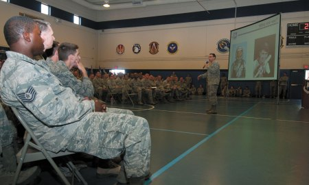 U.S. Air Force photo/Senior Airman Naomi Griego Col. Bill Liquori, 50th Space Wing commander, briefs personnel during an all call at the fitness center April 22, 2015, at Schriever Air Force Base, Colo. The event concluded the base's Wingman Day events.