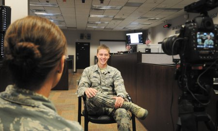 U.S. Air Force photo/2nd Lt. Darren Domingo Staff Sgt. Traci Keller (left), Air Force TV broadcast producer, interviews Airman 1st Class Tyler Daniel, 2nd Space Operations Squadron satellite systems operator, for the next episode of BLUE, the Air Force's flagship television program, in Building 400 at Schriever Air Force Base, Colorado Friday, July 24, 2015. The focus of this episode will be the mission of Air Force Space Command as well as the people that move the mission forward every day.