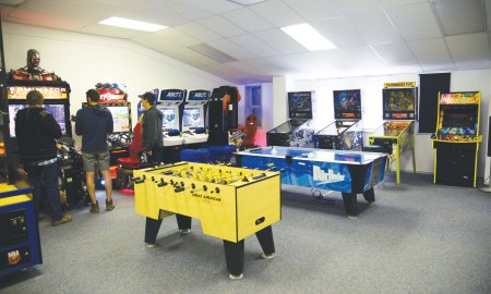 (U.S. Air Force photo by Tech. Sgt. Jared Marquis) THULE AIR BASE, Greenland – Thule Airmen take advantage of the game room during their off-duty hours. Activities offered by Greenland Contractors, as part of the base maintenance contract, activities at the Top of the World Club, Chapel, and other support services, help Airmen adapt to the remote tour at the most remote installation in the Air Force.
