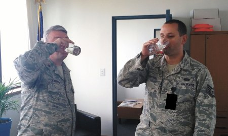 Courtesy photo Maj. George Sanderlin (left), former Detachment 3 commander, and Tech. Sgt. Kyle Fenimore, Det. 3 NCO in-charge, taste test the newly potable water July 8, 2015, at Kaena Point, Hawaii, home of satellite control station HULA. Following many years without drinkable water, in the spring of this year, HULA water was declared potable.