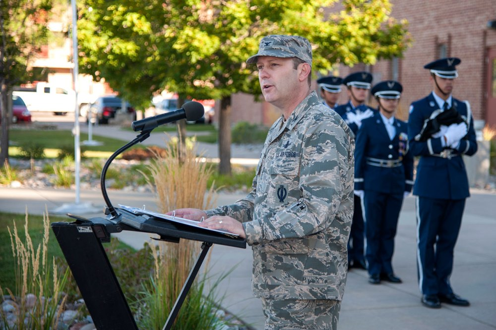 Col. Douglas Schiess, 21st Space Wing commander, addresses Team Pete personnel during a Prisoner of War/Missing in Action Flag Raising