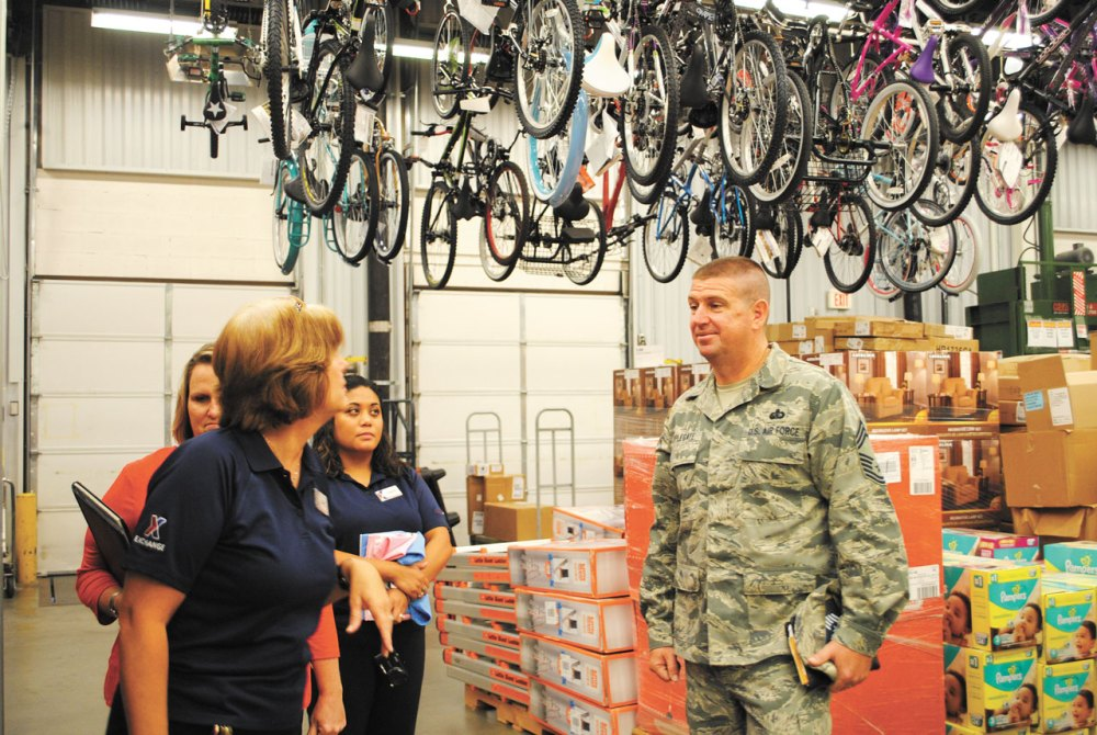 PETERSON AIR FORCE BASE, Colo. — Chief Master Sgt. Sean Applegate, Army & Air Force Exchange Service senior enlisted advisor, tours the stockroom at the Peterson Air Force Base Exchange. Applegate visited Peterson to hear how the Exchange can better serve the military community. (Courtesy photo)