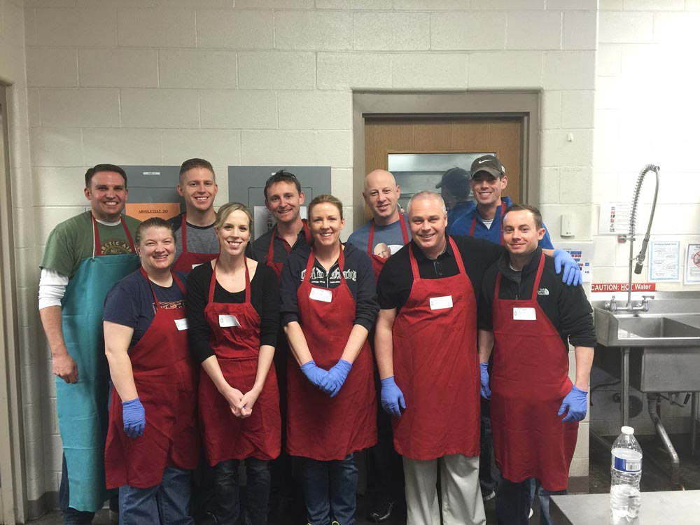 Courtesy photo Airmen with 2nd and 19th Space Operations Squadrons volunteer Feb. 17, 2016, at the Marian House Soup Kitchen in Colorado Springs, Colorado. Twelve volunteers logged 46 hours at the organization to feed the homeless.