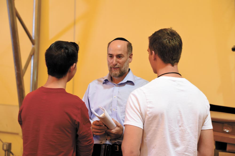 "Ellicott High school students talk with guest speaker Joe Charnes after his speech during the Holocaust Remembrance Day at Schriever Air Force Base, Colorado, Tuesday, Aug. 23, 2016. Charnes, a veteran and Jewish theologian who has been lecturing for years, helped setup the event's ""Holocaust museum"" and continues to partner with Ellicott schools to educate youth on Holocaust importance."