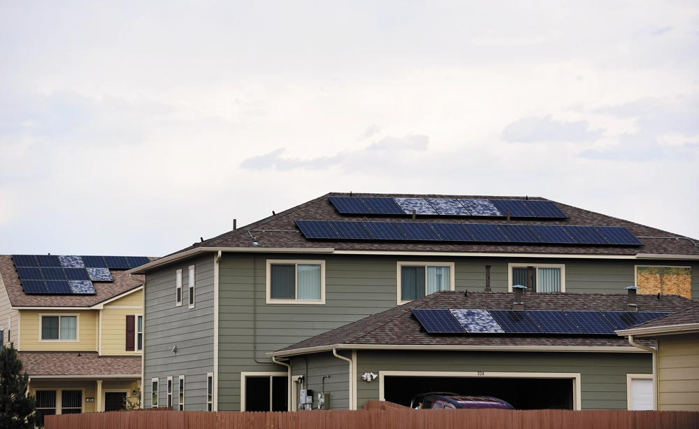 (U.S. Air Force photo by Staff Sgt. Amber Grimm) PETERSON AIR FORCE BASE, Colo.- A row of broken solar panels and boarded up windows showcase the path of the July storm that hit Peterson Air Force Base, Aug. 15, 2016. In family housing, approximately 850 windows were identified as broken, and 60 percent of the solar power system was turned off during the initial inspection round performed by Tierra Vista.