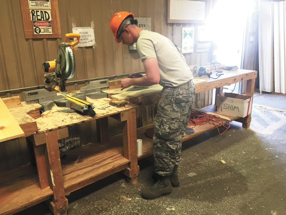Gallup, N.M. — Senior Airman Conner Caron-Burton, 302nd Civil Engineer Squadron engineer apprentice, makes a windowsill for a modular home May 23, 2016 in Gallup, N.M. Eighty five percent of the modular homes are built in a warehouse and transported to the home site when finished. A team of twenty-four Air Force Reservists from the 302nd CES traveled to N.M. for Innovative Readiness Training to help build new homes for the Navajo nation and develop tradesman skills.
