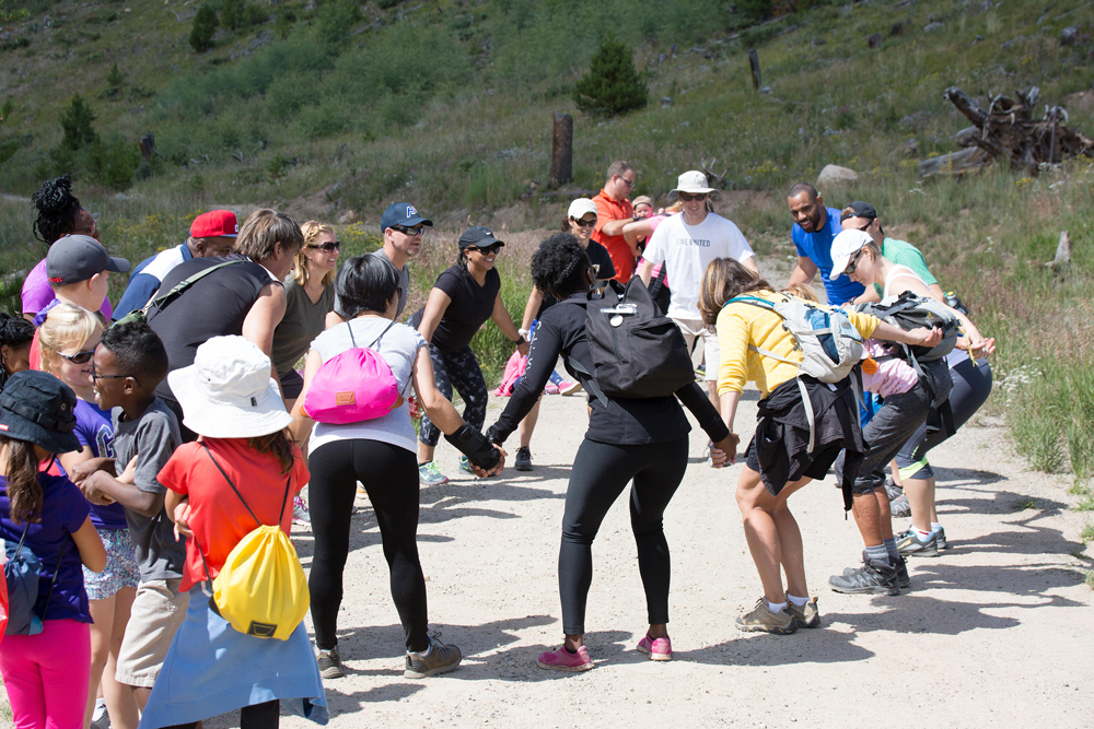 Courtesy photo Family members celebrate after reaching the peak of a hike in the Keystone Resort at Keystone, Colorado, Saturday, Aug. 13, 2016. The 50th Space Wing Chapel Office sponsored the retreat to give families a chance to focus on bonding.