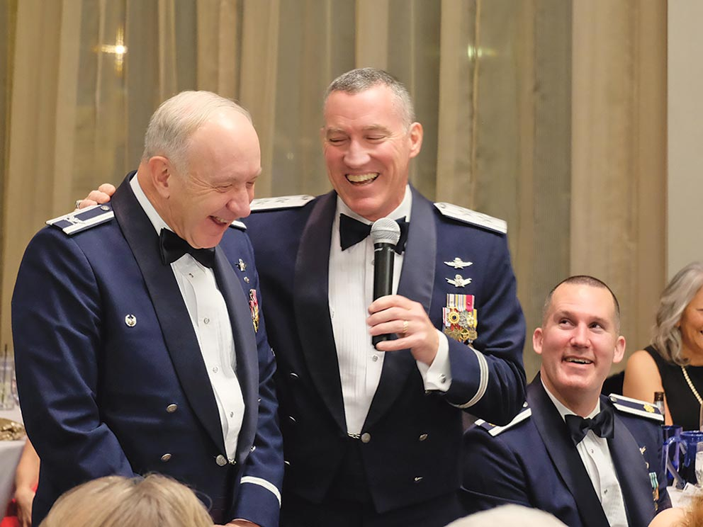 """U.S. Air Force photo/Senior Airman Brandon Files Retired Col. Jack Anthony, 1st Space Operations Squadron commander from July 1996 – July 1998, laughs with Maj. Gen. Burke E. Wilson, Deputy Principal Cyber Advisor to the Secretary of Defense and Senior Military Advisor for Cyber, Office of the Under Secretary of Defense for Policy, Office of the Secretary of Defense, the Pentagon, Washington, D.C. during the squadron's 25th anniversary celebration at The Mining Exchange in Colorado Springs, Colorado, Friday, Jan. 27, 2017. Wilson was the 1 SOPS commander from July 2002 – July 2003. The former commanders recalled their prior service together as """"Captain Wilson"""" and """"Major Anthony."""""""