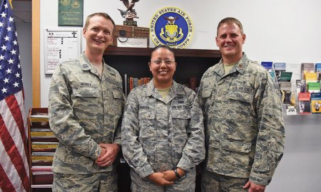 U.S. Air Force photo/Senior Airman Arielle Vasquez Chaplain (Capt.) Portmann Werner, 50th Space Wing chaplain, Staff Sgt. Marcela Parker, NCO in charge of chapel administration and Chaplain (Maj.) David Hager, Individual Mobilization Augmentee to the Wing Chaplain, gather for a photo at Schriever Air Force Base, Colorado, Wednesday, July 5, 2017. Regardless of one's religious background and beliefs, the Chaplain's Office is here to provide a number of services to keep Airmen spiritually resilient and fit to fight.