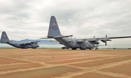 (U.S. Air Force photo by Senior Airman Lauren Douglas) Dobbins Air Reserve Base, Ga — Two C-130H Hercules from the 94th Airlift Wing, Dobbins Air Reserve Base, Ga. are parked on the flightline at Peterson Air Force Base, Colo. Aug. 3, 2017. The two aircraft participated with other C-130s in high-altitude airdrops in the Colorado Rockies.
