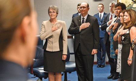 (U.S. Air Force photo by Scott M. Ash) Arlington County, Va. — Secretary of the Air Force Heather Wilson and to-be sworn in undersecretary of the Air Force Matthew Donovan stand during the National Anthem at his swearing-in ceremony at the Pentagon in Arlington County, Va., Aug. 11, 2017.