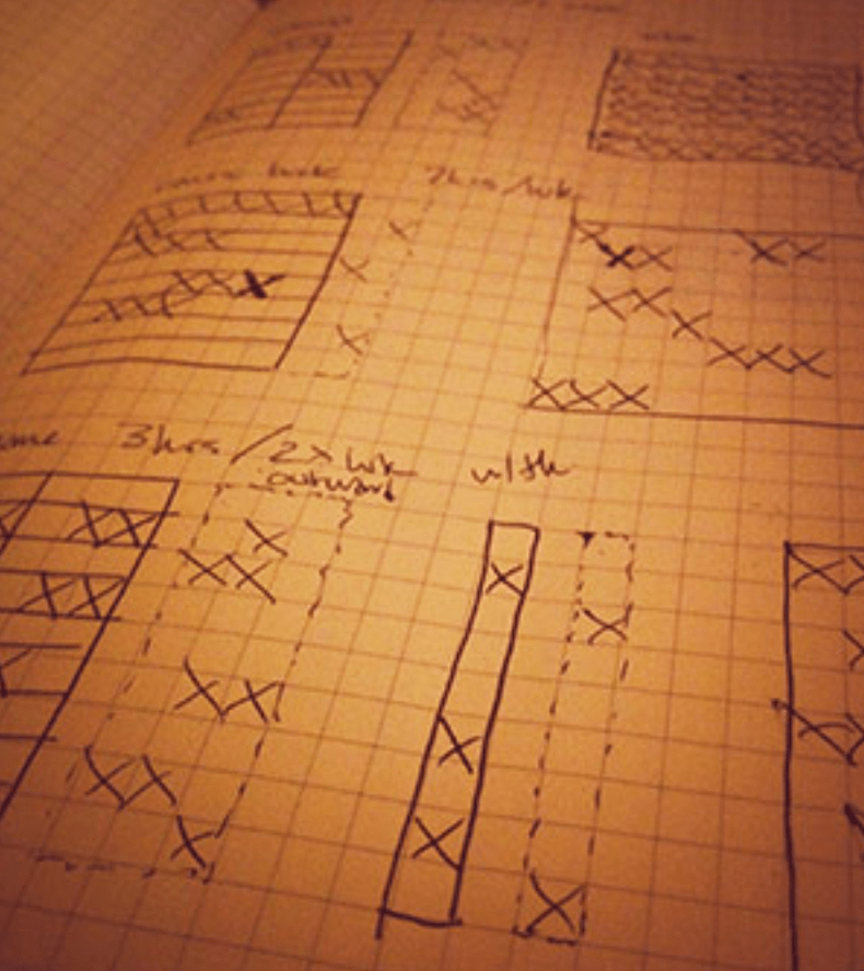 grid of X drawn out on a moleskine sketchbook