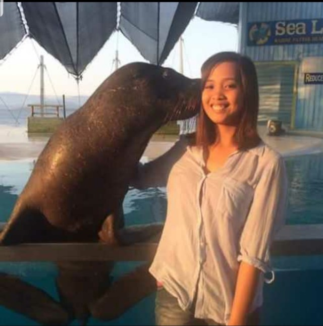 Cute Lyca with seal in Philippines