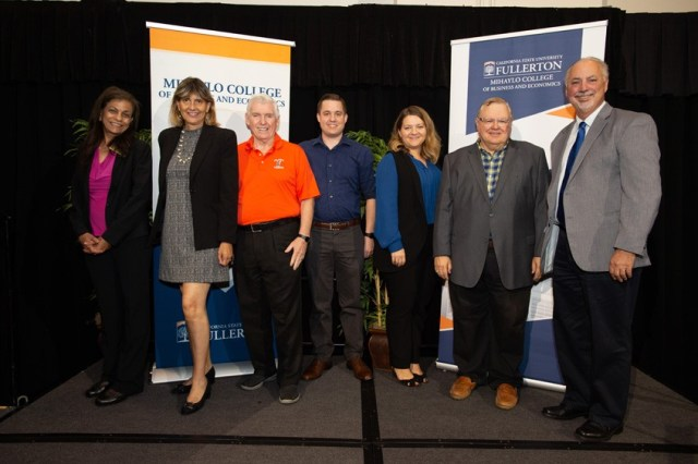 From left to right: CSUF Center for Economic Education Director Radha Bhattacharya, CSUF Professor Dr. Deborah Ferber, entrepreneur and philanthropist Dan Black, philanthropist Karl Freels, VP, Credit Executive, MUFG Union Bank, N.A. Natalia Razeghi, CSUF Center for Entrepreneurship Director John Bradley Jackson, and the founer of Guchereau Company Ken Guchereau. University student presenting at the Titan Fast Pitch 2018 Finals. Photo credit: Matt Petit for MUFG Union Bank, N.A.