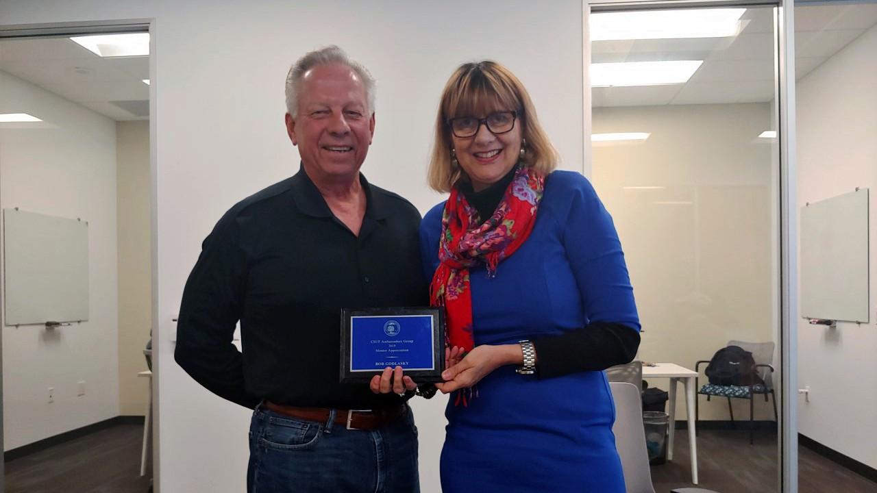 Bob Godlasky Accepting Award from Dr. Deborah Ferber