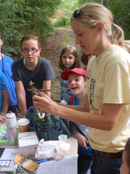 A Global Program Protecting Birds in Our Backyard   Audubon Connecticut Corrie Folsom O Keefe  Audubon Connecticut Important Bird Area Program  Coordinator  demonstrates bird banding to students