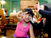 she's still practicing. she covers her face everytime she makes the peace sign.