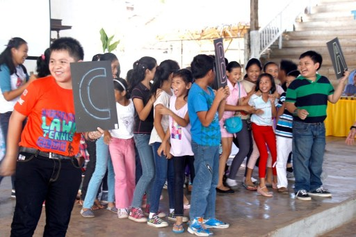 Kids having fun during the quiz contest on the Coral Triangle