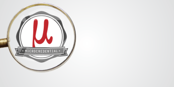 Microcredntial logo under a magnifying glass.
